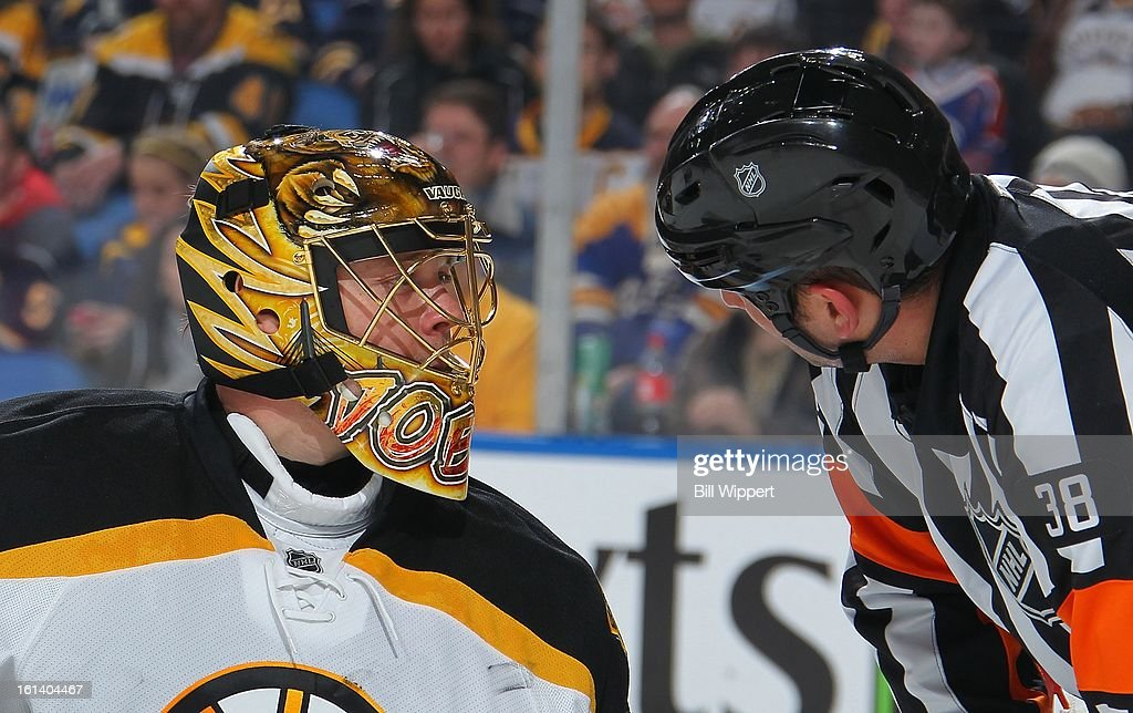 Anton Khudobin #35 of the Boston Bruins talks with referee Francois St. Laurent #38 during their game against the Buffalo Sabres on February 10, 2013 at the First Niagara Center in Buffalo, New York.
