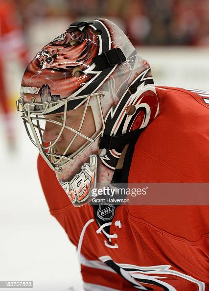 Anton Khudobin of the Carolina Hurricanes against the Philadelphia Flyers during play at PNC Arena on October 6 2013 in Raleigh North Carolina The...