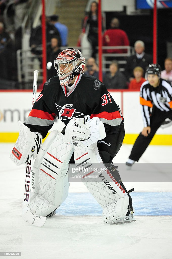 Anton Khudobin of the Carolina Hurricanes against the Phoenix Coyotes during play at PNC Arena on October 13 2013 in Raleigh North Carolina The...