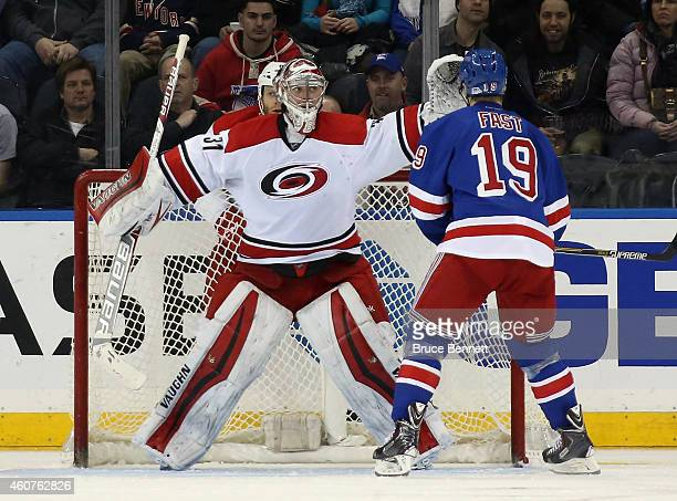 Anton Khudobin of the Carolina Hurricanes blocks the view for Jesper Fast of the New York Rangers during the third period at Madison Square Garden on...