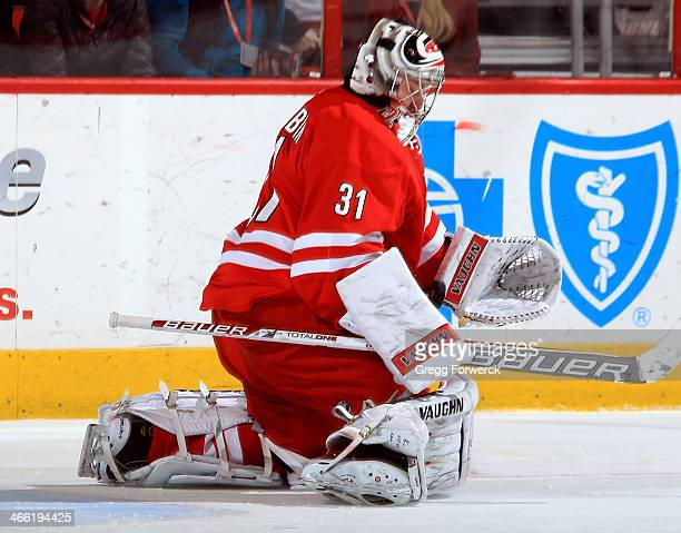 Anton Khudobin of the Carolina Hurricanes bodies down a St Louis Blues shot during their NHL game at PNC Arena on January 31 2014 in Raleigh North...
