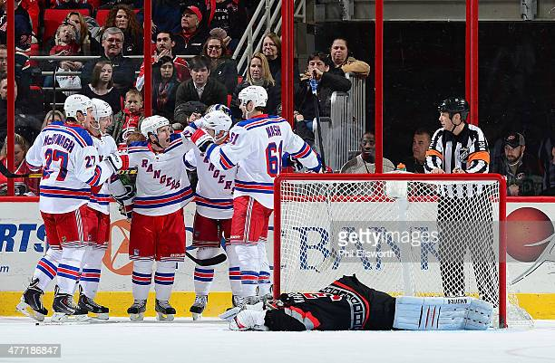 Anton Khudobin of the Carolina Hurricanes lays in the crease as Ryan McDonagh Martin St Louis Brad Richards and Rick Nash celebrate a thirdperiod...