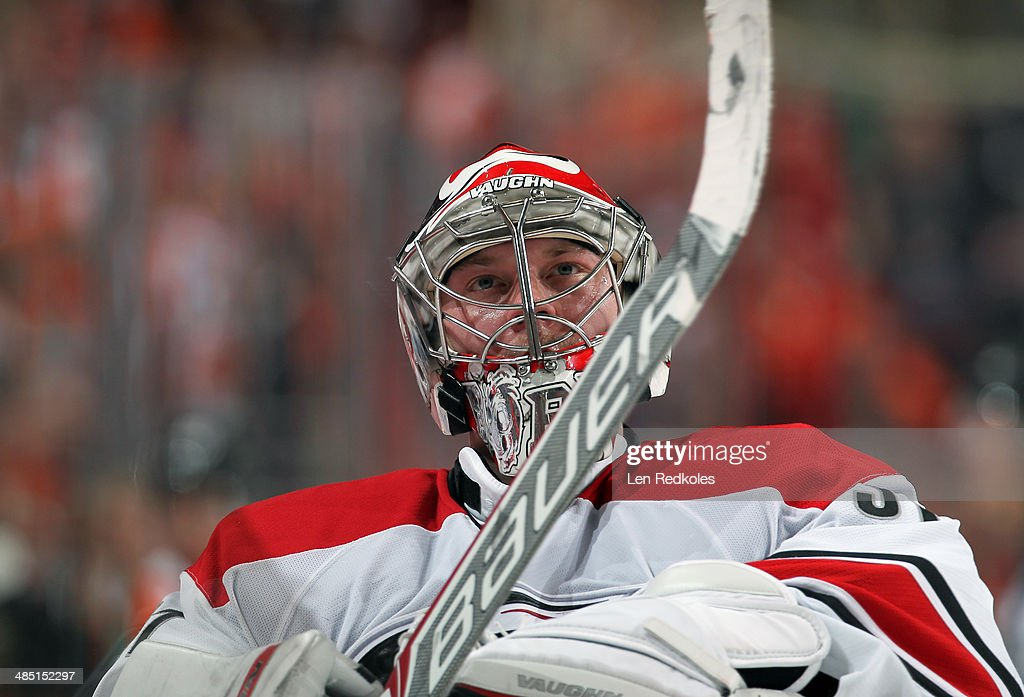 Anton Khudobin #31 of the Carolina Hurricanes looks on prior to a shootout against the Philadelphia Flyers on April 13, 2014 at the Wells Fargo Center in Philadelphia, Pennsylvania. The Hurricanes went on to defeat the Flyers 6-5 in a shootout.