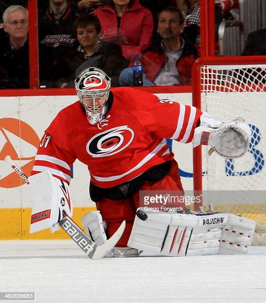 Anton Khudobin of the Carolina Hurricanes makes a save during an NHL game against the Nashville Predators at PNC Arena on January 5 2014 in Raleigh...