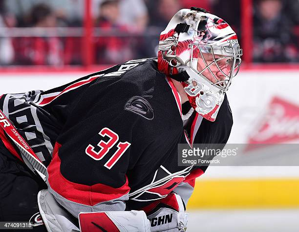 Anton Khudobin of the Carolina Hurricanes prepares for a faceoff against the Washington Capitals during an NHL game on February 27 2015 at PNC Arena...