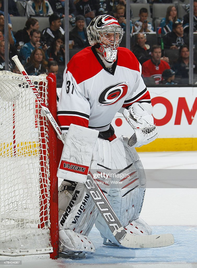 Anton Khudobin of the Carolina Hurricanes protects the net against the San Jose Sharks at SAP Center on March 4 2014 in San Jose California
