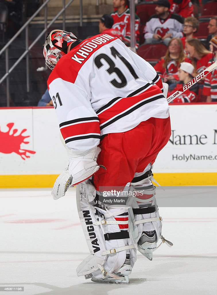 Anton Khudobin of the Carolina Hurricanes reacts after defeating the New Jersey Devils for his first win of the season at the Prudential Center on...
