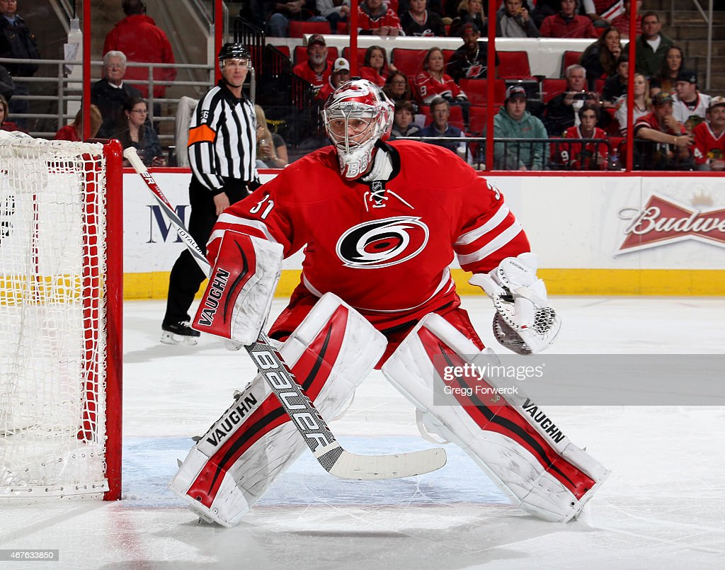 Anton Khudobin of the Carolina Hurricanes stands tall in the crease and keeps his eye on the puck during their NHL game against the Chicago...