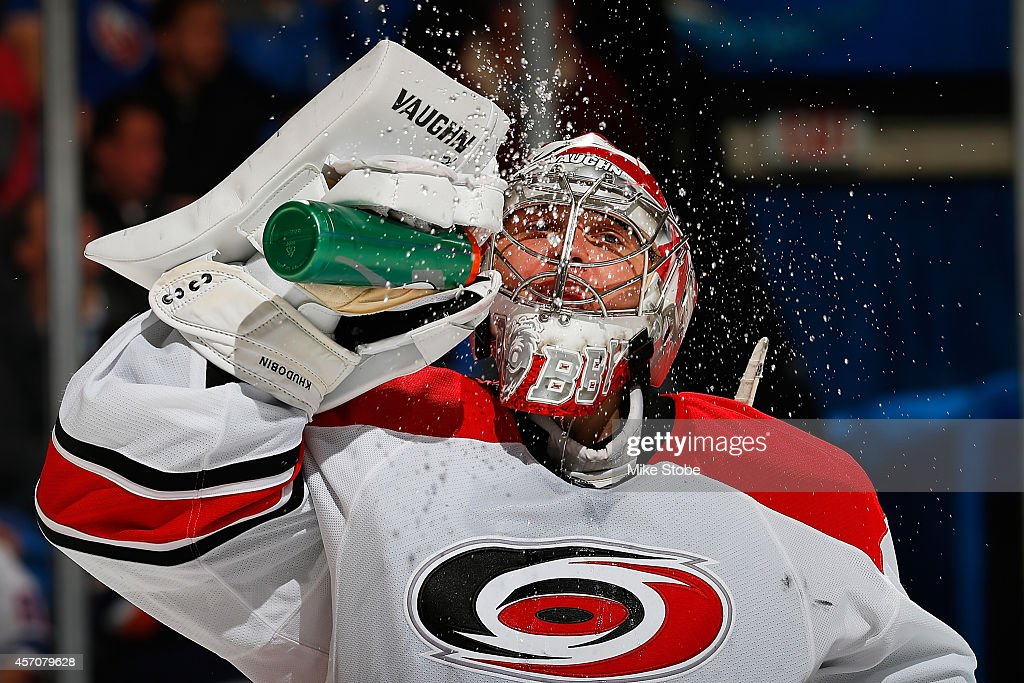 <a gi-track='captionPersonalityLinkClicked' href=/galleries/search?phrase=Anton+Khudobin&family=editorial&specificpeople=722106 ng-click='$event.stopPropagation()'>Anton Khudobin</a> #31 of the Carolina Hurricanes takes a break during a stoppage of play durring a game against the New York Islanders at Nassau Veterans Memorial Coliseum on October 11, 2014 in Uniondale, New York.