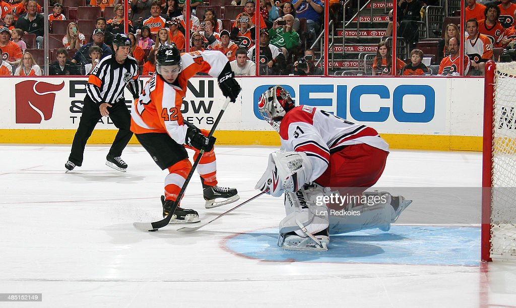 Anton Khudobin #31 of the Carolina Hurricanes will stop a shot on goal during a shootout by Jason Akeson #42 of the Philadelphia Flyers on April 13, 2014 at the Wells Fargo Center in Philadelphia, Pennsylvania. The Hurricanes went on to defeat the Flyers 6-5 in a shootout.