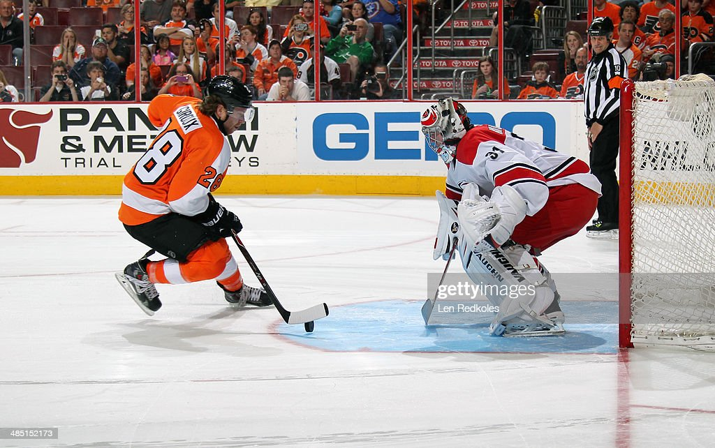 Anton Khudobin #31 of the Carolina Hurricanes will stop a shot on goal during a shootout by Claude Giroux #28 of the Philadelphia Flyers on April 13, 2014 at the Wells Fargo Center in Philadelphia, Pennsylvania. The Hurricanes went on to defeat the Flyers 6-5 in a shootout.