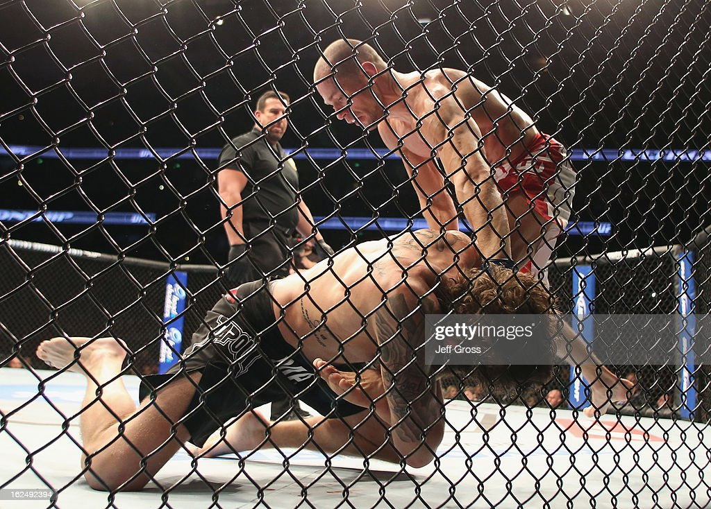 Anton Kuivanen of Finland and <a gi-track='captionPersonalityLinkClicked' href=/galleries/search?phrase=Michael+Chiesa&family=editorial&specificpeople=9006046 ng-click='$event.stopPropagation()'>Michael Chiesa</a> fight following their UFC Lightweight bout at Honda Center on February 23, 2013 in Anaheim, California.