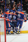 Anton Lander# 51 Taylor Hall Andrew Miller and Justin Schultz of the Edmonton Oilers celebrate after scoring a goal during the game against the...