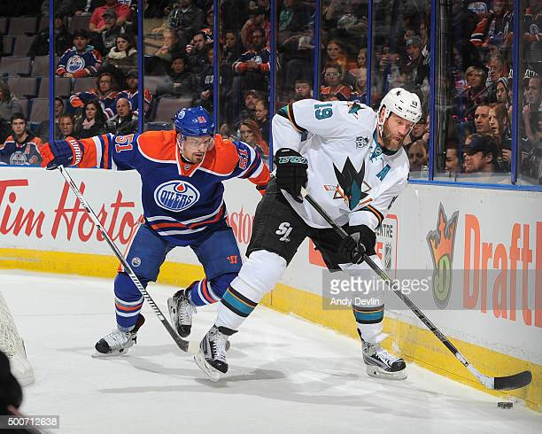 Anton Lander of the Edmonton Oilers battles for the puck against Joe Thornton of the San Jose Shark on December 2015 at Rexall Place in Edmonton...
