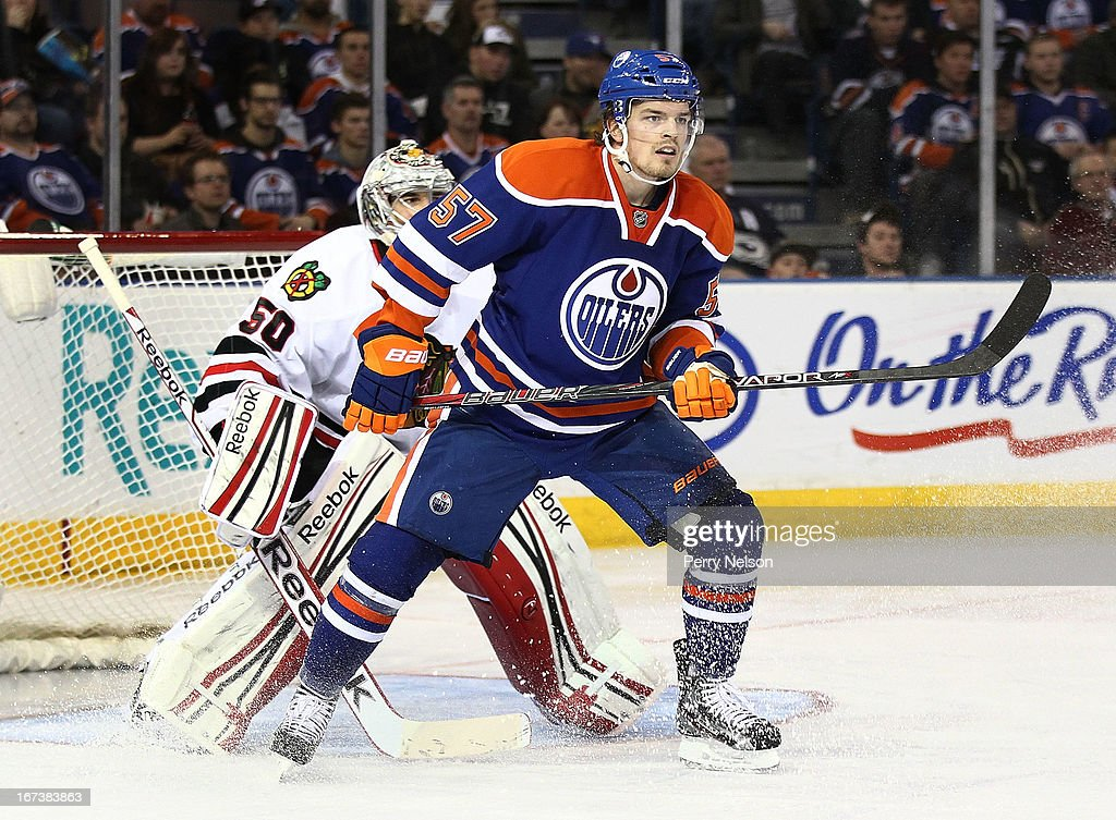 Anton Lander #57 of the Edmonton Oilers screens goaltender <a gi-track='captionPersonalityLinkClicked' href=/galleries/search?phrase=Corey+Crawford&family=editorial&specificpeople=818935 ng-click='$event.stopPropagation()'>Corey Crawford</a> #50 of the Chicago Blackhawks at Rexall Place on April 24, 2013 in Edmonton, Alberta, Canada.