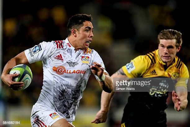 Anton Lienert Brown of the Chiefs makes a break past Jason Woodward of the Hurricanes during the Super Rugby Semi Final match between the Hurricanes...