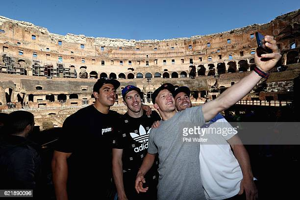 Anton LienertBrown Brodie Retallick Damian McKenzie and Ryan Crotty of the New Zealand All Blacks take a photo inside the Colosseum on November 9...