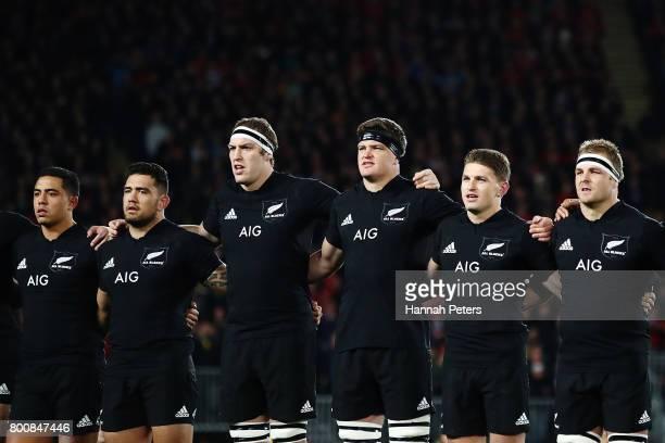Anton LienertBrown Codie Taylor Brodie Retallick Scott Barrett Beauden Barrett and Sam Cane of the All Blacks sing the national anthem ahead of the...