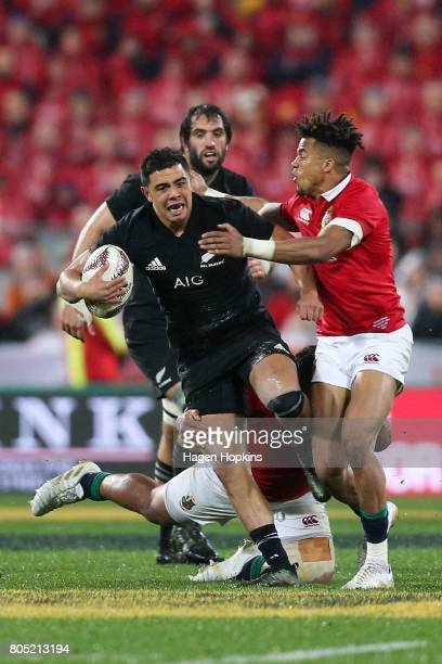 Anton LienertBrown of New Zealand is tackled by Anthony Watson of the Lions during the International Test match between the New Zealand All Blacks...