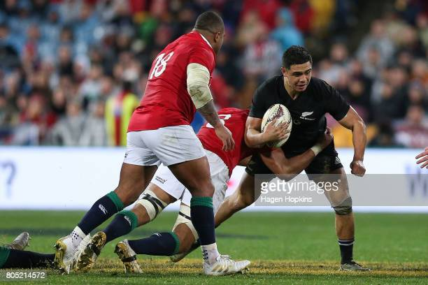 Anton LienertBrown of New Zealand is tackled by Taulupe Faletau of the Lions during the International Test match between the New Zealand All Blacks...