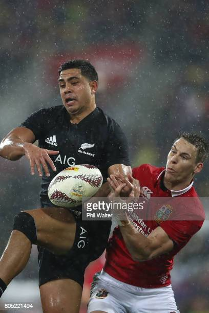 Anton LienertBrown of the All Blacks and Liam Williams of the Lions contest the ball during the International Test match between the New Zealand All...