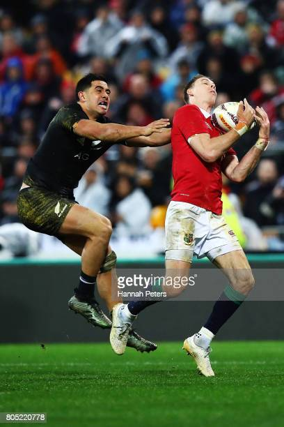 Anton LienertBrown of the All Blacks competes with Liam Williams of the Lions for the ball during the International Test match between the New...