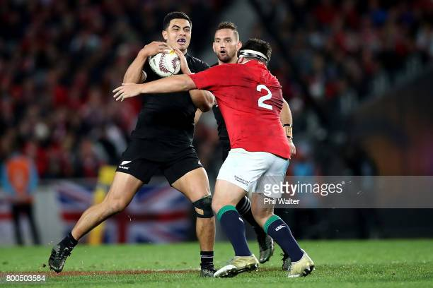 Anton LienertBrown of the All Blacks is tackled during the Test match between the New Zealand All Blacks and the British Irish Lions at Eden Park on...