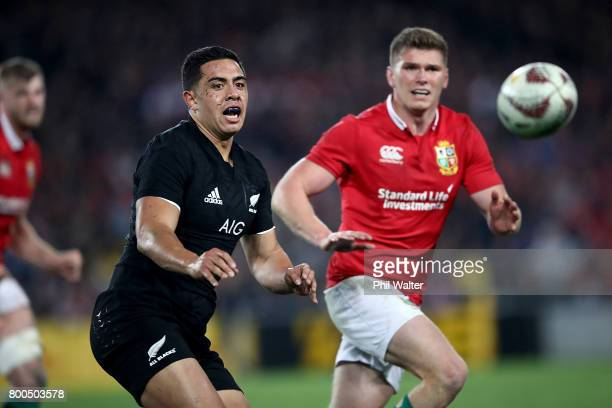 Anton LienertBrown of the All Blacks offloads the ball during the Test match between the New Zealand All Blacks and the British Irish Lions at Eden...