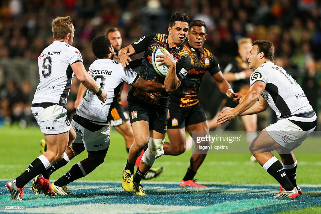 Anton Lienert-Brown of the Chiefs is tackled by Garth April and Andre Esterhuizen of the Sharks during the round 10 Super Rugby match between the Chiefs and the Sharks at Yarrow Stadium on April 29, 2016 in New Plymouth, New Zealand.