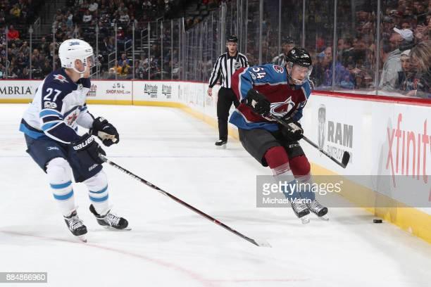 Anton Lindholm of the Colorado Avalanche skates against Nikolaj Ehlers of the Winnipeg Jets at the Pepsi Center on November 29 2017 in Denver Colorado