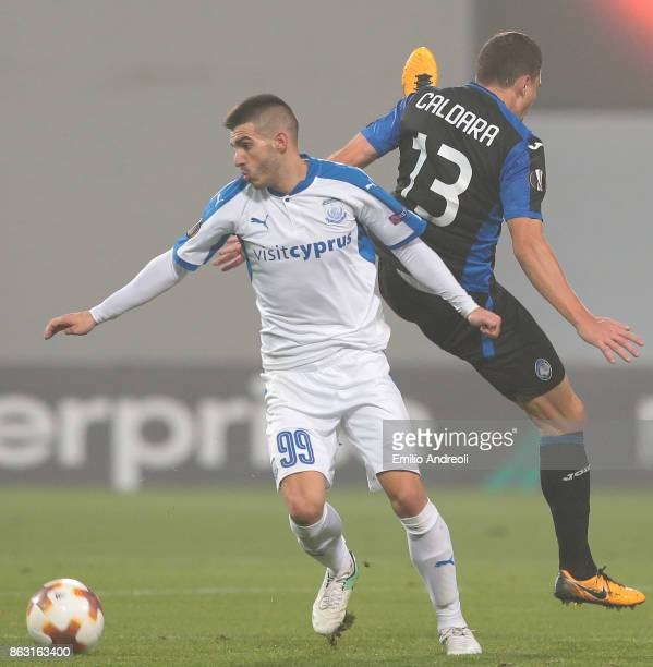 Anton Maglica of Apollon Limassol FC competes for the ball with Mattia Caldara of Atalanta BC during the UEFA Europa League group E match between...