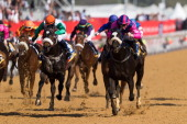Anton Marcus riding Resolution wins the 1400m Igugu 2011 FM 84 Handicap race during the 2014 Vodacom Durban July races at Greyville Racecourse on...