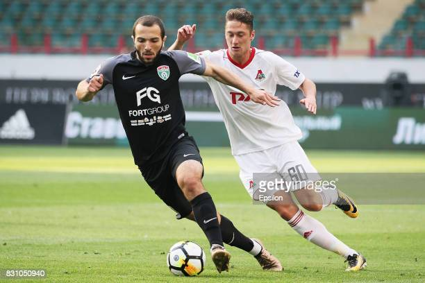 Anton Miranchuk of FC Lokomotiv Moscow vies for the ball with Georgi Melkadze of FC Tosno Khabarovsk during the Russian Premier League match between...