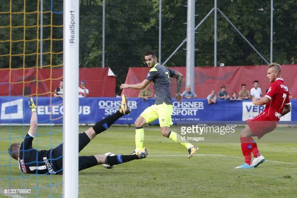 Anton Mitryushkin of FC Sion Gaston Pereiro of PSV Frederico Dimarco of FC Sion during the friendly match between FC Sion and PSV Eindhoven at Stade...