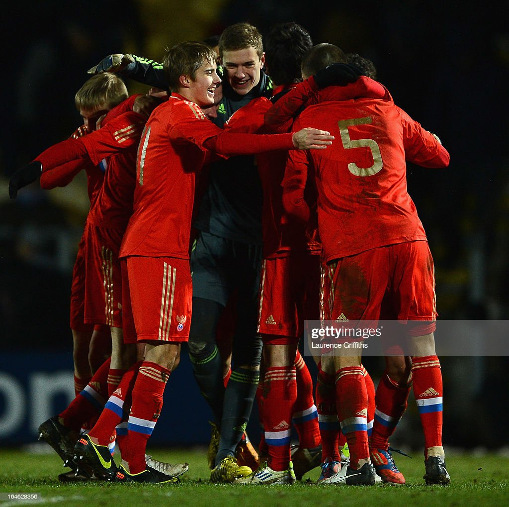 Anton Mitryushkin of Russia lead the celebrations after victory after the UEFA European Under-17 Championship Elite Round match between England Under-17 and Russia U-17at Pirelli Stadium on March 25, 2013 in Burton-upon-Trent, England.