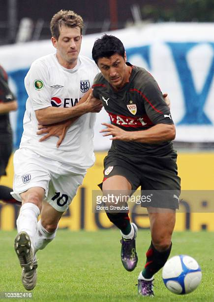 Anton Mueller of Babelsberg and Ciprian Marica of Stuttgart battle for the ball during the DFB Cup first round match between SV Babelsberg and VfB...