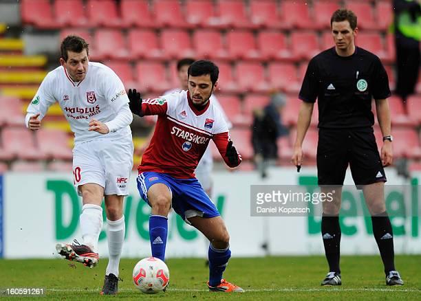 Anton Mueller of Halle is challenged by Yasin Yilmaz of Unterhaching during the third Bundesliga match between SpVgg Unterhaching and Hallescher FC...