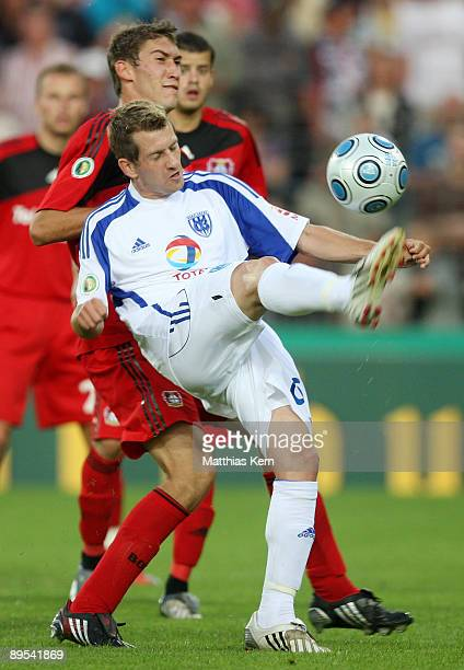 Anton Mueller of Potsdam battles for the ball with Stefan Reinartz of Leverkusen during the DFB Cup first round match between SV Babelsberg 03 and...