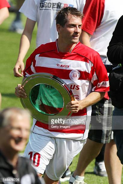 Anton Muller of Halle with the Masterful Shell trophy during the Regionalliga Nord match between Hallescher FC and RB Leipzig at Erdgas Sportpark on...