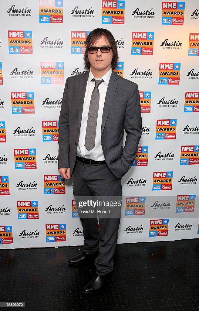 Anton Newcombe poses in the winner's room at the NME Awards at Brixton Academy on February 18, 2015 in London, England.