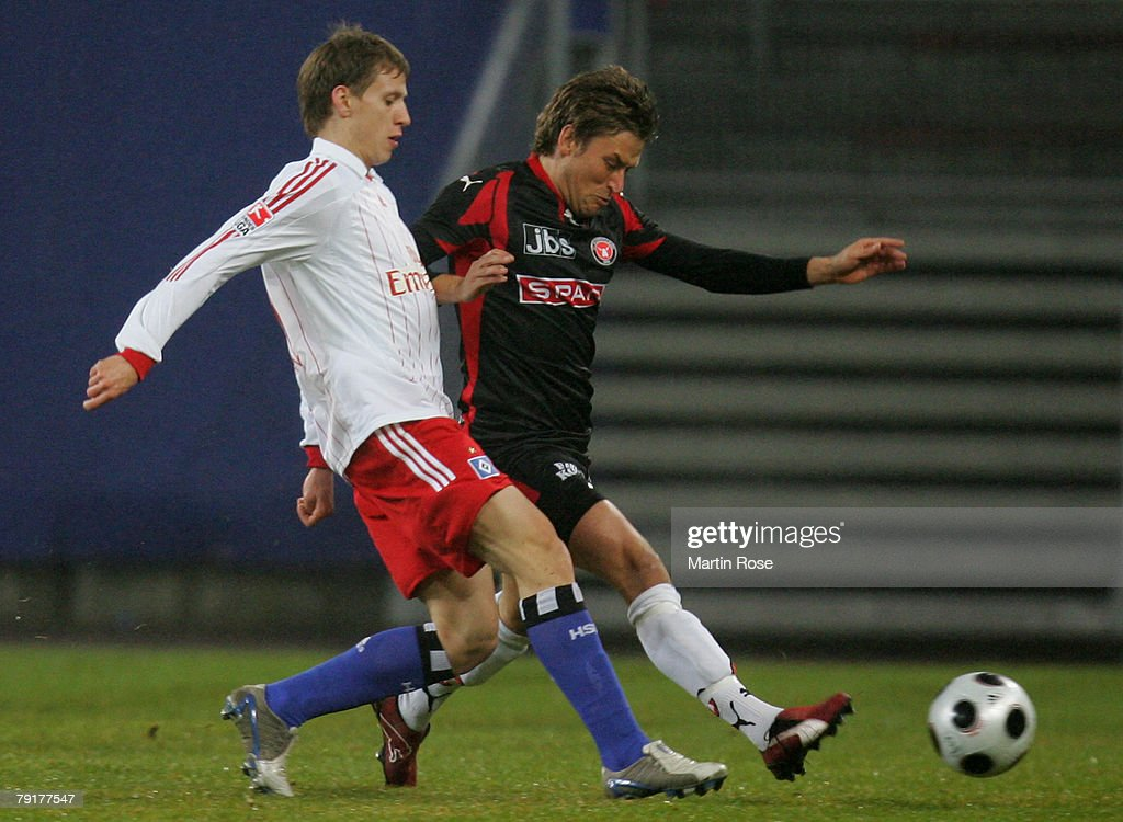 Anton Putsilo (L) of Hamburg and Christopher Poulsen (R) of Midtjyland compete for the ball during the friendly match between Hamburger SV and FC Midtjyland at the HSH Nordbank Arena on January 23, 2008 in Hamburg, Germany.