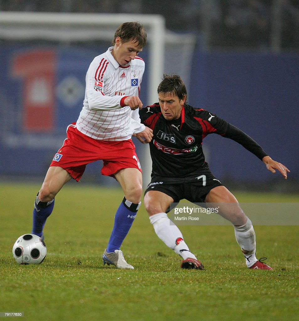 Anton Putsilo (L) of Hamburg and Claus Madsen (R) of Midtjyland compete for the ball during the friendly match between Hamburger SV and FC Midtjyland at the HSH Nordbank Arena on January 23, 2008 in Hamburg, Germany.
