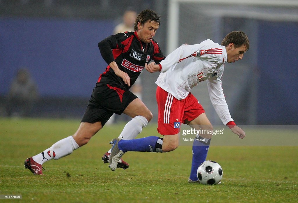 Anton Putsilo (R) of Hamburg and Claus Madsen (L) of Midtjyland compete for the ball during the friendly match between Hamburger SV and FC Midtjyland at the HSH Nordbank Arena on January 23, 2008 in Hamburg, Germany.