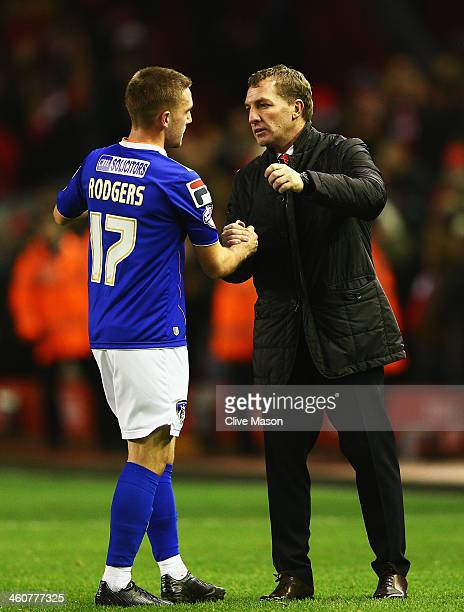 Anton Rodgers of Oldham shakes hands with his father Liverpool manager Brendan Rodgers after the Budweiser FA Cup third round match between Liverpool...