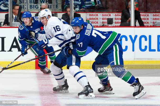 Anton Rodin of the Vancouver Canucks checks Mitchell Marner of the Toronto Maple Leafs during their NHL game at Rogers Arena December 2 2017 in...