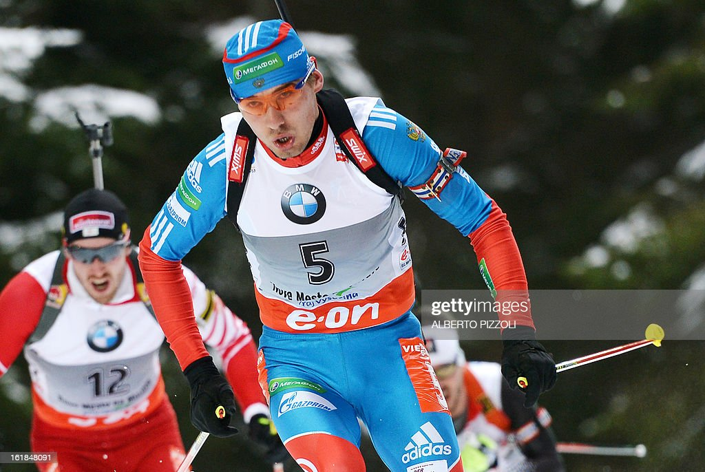 Anton Shipulin of Russia (R) and Austria's Dominik Landertinger compete during the men's 15 km mass start as part of the IBU Biathlon World Championships in Nove Mesto, Czech Republic, on February 17, 2013. Tarjei Boe of Norway won the race ahead of Anton Shipulin of Russia and Emil Hegle Svendsen of Norway.