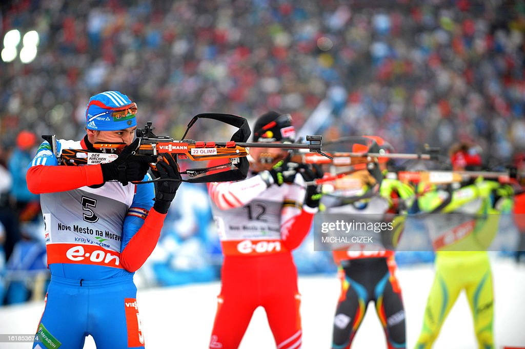 Anton Shipulin (L) of Russia competes in the men's 15 km mass start event as part of IBU Biathlon World Championships in Nove Mesto, Czech Republic, on February 17, 2013. Tarjei Boe of Norway won the race ahead of Anton Shipulin of Russia and Emil Hegle Svendsen of Norway.