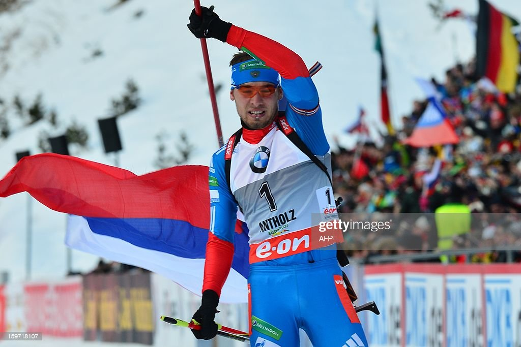 Anton Shipulin of Russia crosses the finish line of the 12,5 kilometers' pursuit race of the men's biathlon World Cup race in victory on January 19, 2013 in Antholz-Anterselva. Anton Shipulin of Russia won ahead of Jakov Fak of Slovenia and Daniel Mesotitsch of Austria.