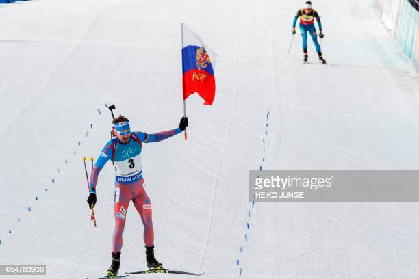 Anton Shipulin of Russia finish first placed in front of Martin Fourcade of France during the IBU Biathlon World Cup Biathlon Men 125 km pursuit...