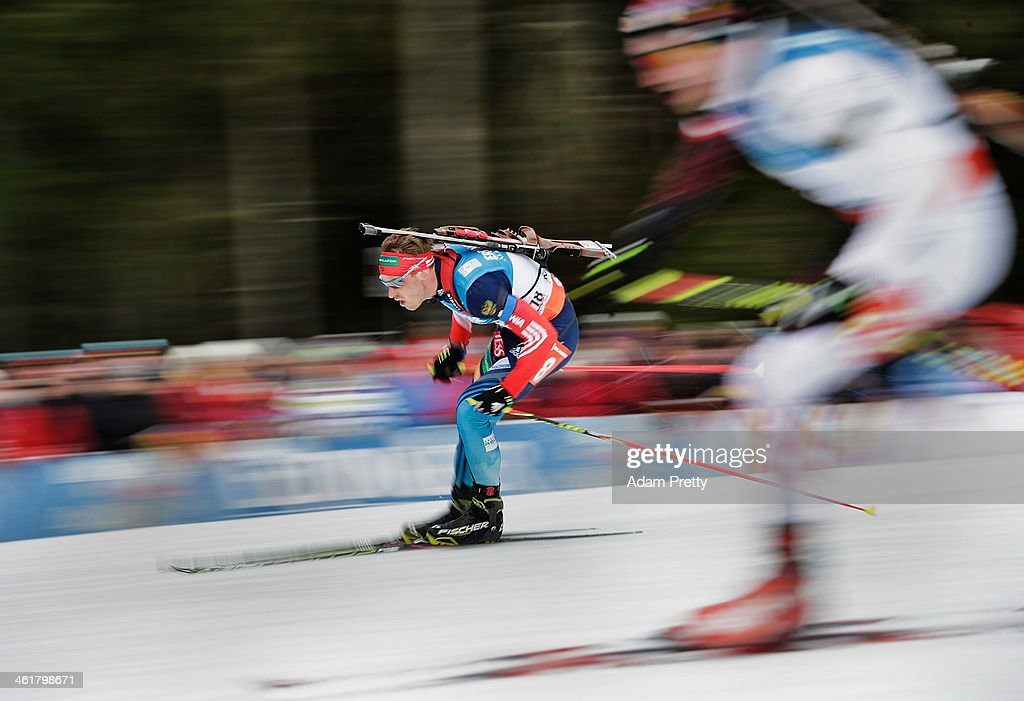 Anton Shipulin of Russia overtakes another comopetitor on the downhill section during the 20km mens individual on day four of the E.On IBU World Cup Biathlonon January 11, 2014 in Ruhpolding, Germany.